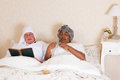 Vintage bedroom with elderly couple Royalty Free Stock Images