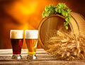 Vintage beer barrel and two glasses. Brewing concept Royalty Free Stock Photo