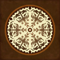 Vintage beige abstract background round with doodle mandala Royalty Free Stock Images