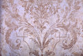 Vintage beige rundown victorian wallpaper detail of with baroque vignette Stock Photos