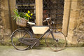 Vintage bicycle with bunches of flowers Stock Image