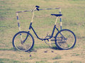 Vintage bicycle on the field bike leaning against metal frame of goal a rundown playground Royalty Free Stock Photos