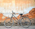 Vintage bicycle in front of old brick wall in chiangkhan thailand Stock Photo