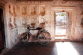 Vintage bicycle leaning against the wall two bicycles of old patterned indian temple Royalty Free Stock Images
