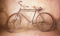 Vintage bicycle old rusty in front of the wall time passing concept Royalty Free Stock Images