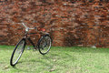 Vintage bicycle and red brick wall retro stylish cycling in town Stock Image