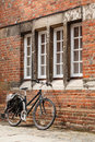 Vintage bicycle retro leaning against an old brick wall Royalty Free Stock Images