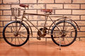 Vintage bicycle single speed against a brick background Royalty Free Stock Image