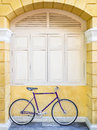 Vintage bicycle on Wall Window frame Hipster lifestyle Royalty Free Stock Photo