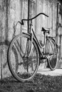 Vintage bike bicycle standing near a wood wall Royalty Free Stock Photography