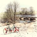 Vintage bike old bicycle on off road terrain near the river stylization Stock Photo