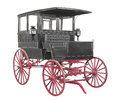 Vintage black carriage isolated fancy horse drawn with kerosene lights red wheels and an enclosed cab with windows on white Royalty Free Stock Photos