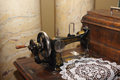Vintage black sewing machine left view photo Royalty Free Stock Images