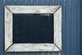 Vintage blackboard on a wooden wall Royalty Free Stock Photo