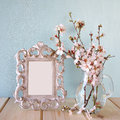 Vintage blank frame next to white spring flowers. selective focus. template, ready to put photography Royalty Free Stock Photo