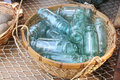 Vintage Blue Glass Bottles Collection in Wicker Basket Royalty Free Stock Photo