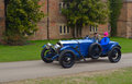 Vintage blue racing car in front of old building. Royalty Free Stock Photo