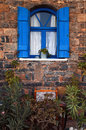 Vintage blue window, Greece. Stock Photos