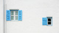 Vintage blue windows on the wall Stock Photos