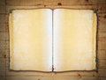 Vintage book on old wooden background clipping path with Royalty Free Stock Image