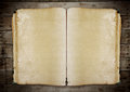 Vintage book on old wooden background clipping path. Royalty Free Stock Photo