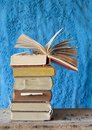 Vintage books stack of on blue background Royalty Free Stock Image