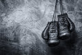 Vintage boxing gloves hanging on the old wall Royalty Free Stock Photo