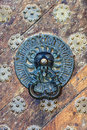 Vintage brass knob on the old wooden door Royalty Free Stock Photo