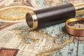 Vintage brass telescope on antique map Stock Image