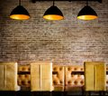 Vintage brick wall with pendant luminaires Royalty Free Stock Photo