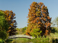 Vintage bridge over lake with late october autumn colors Stock Photo
