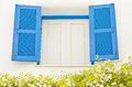 Vintage bright blue window and flowers focus at the Royalty Free Stock Photography