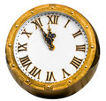 Vintage bronze clock five minutes before midnight Royalty Free Stock Images