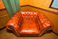 Vintage brown leather armchair Stock Image