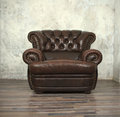 Vintage brown leather chair in empty room Royalty Free Stock Photo