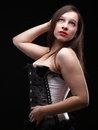 Vintage brunette i white corselette ii corset black background fashion photo Royalty Free Stock Images