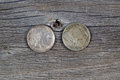 Vintage buffalo nickels on age wood closeup image of american reverse and obverse sides rustic Stock Photo