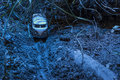 Vintage bus VW. Small metal toy in the nature in the night Royalty Free Stock Photo