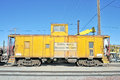 Vintage caboose this yellow union pacific has been retired from service and is on display at the western area railroad museum in Stock Image