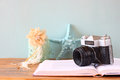 Vintage camera book and decorations over wooden shelf Stock Images