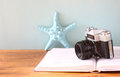 Vintage camera book and decorations over wooden shelf Stock Photography