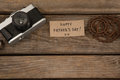 Vintage camera, card and gear on wooden plank Royalty Free Stock Photo