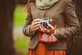 Vintage camera in the hands of the girl Royalty Free Stock Photo