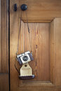 Vintage camera hanging against a wooden door Stock Photo