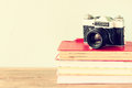 Vintage camera on old books. vintage effect Royalty Free Stock Photo
