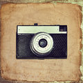 Old paper, vintage photo frame with camera Royalty Free Stock Photo