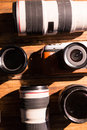 A vintage camera with retro revival and lens cap on wooden table Stock Photos