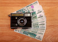 Vintage camera russian currency wooden background Royalty Free Stock Image