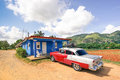 Vintage car Chevrolet Bel Air parked at farmer place in country side of Cuba Royalty Free Stock Photo