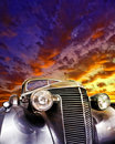 Vintage car large brightly coloured sunset Royalty Free Stock Photos
